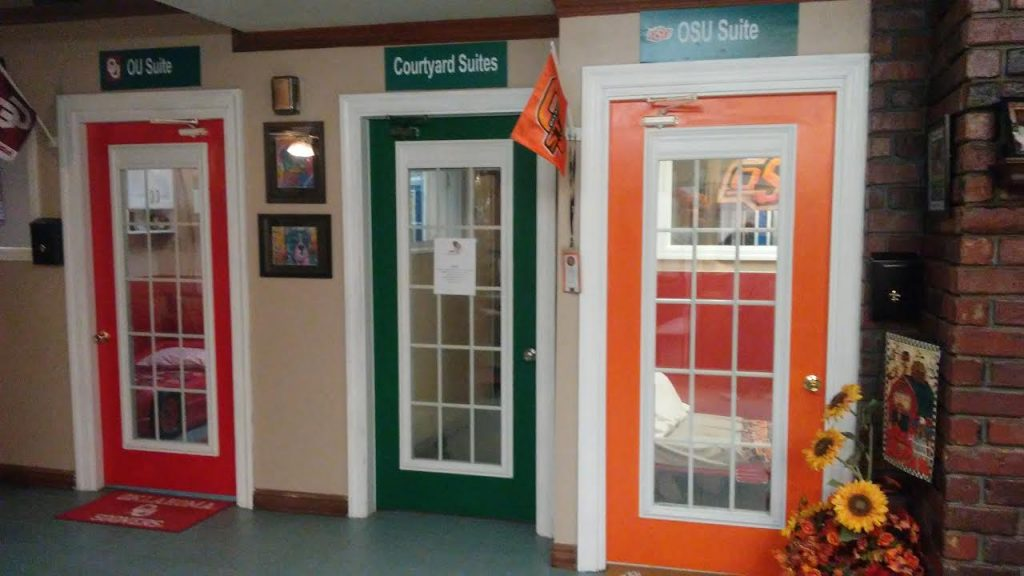 OU and OSU luxury suites for dogs with web cameras at Woodland West Pet Resort in Tulsa, Oklahoma
